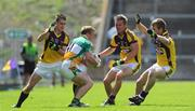 4 July 2009; Sean Ryan, Offaly, in action against Adrian Flynn, left, Aindreas Doyle and P.J. Banville, Wexford. GAA All-Ireland Senior Football Championship Qualifier, Round 1, Wexford v Offaly, Wexford Park, Wexford. Picture credit: Ray McManus / SPORTSFILE