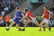 4 July 2009; Rory Woods, Monaghan, in action against Aidan O'Rourke, Armagh. GAA Football Ulster All-Ireland Senior Championship Qualifier, Round 1, Monaghan v Armagh, St. Tighearnach's Park, Clones, Co. Monaghan. Picture credit: Oliver McVeigh / SPORTSFILE