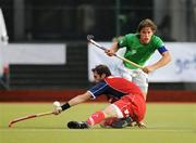 6 July 2009; Ronan Gormley, Ireland, in action against Cristobal Rodriguez, Chile. FIH Champions Challenge II, Ireland v Chile, National Hockey Stadium, UCD, Belfield, Dublin. Picture credit: Paul Mohan / SPORTSFILE