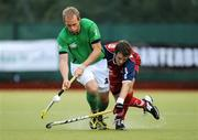 6 July 2009; Timothy Cockram, Ireland, in action against Thomas Kannegiesser, Chile. FIH Champions Challenge II, Ireland v Chile, National Hockey Stadium, UCD, Belfield, Dublin. Picture credit: Paul Mohan / SPORTSFILE