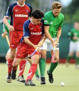 6 July 2009; Mitch Darling, Ireland, in action against Matias Amoroso, Chile. FIH Champions Challenge II, Ireland v Chile, National Hockey Stadium, UCD, Belfield, Dublin. Picture credit: Paul Mohan / SPORTSFILE
