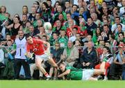 5 July 2009; Graham Canty, Cork, is tackled by Jason Stokes, Limerick. GAA Football Munster Senior Championship Final, Limerick v Cork, Pairc Ui Chaoimh, Cork. Picture credit: Diarmuid Greene / SPORTSFILE