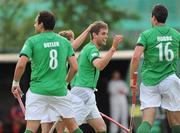 7 July 2009; Ireland's John Jermyn, centre, celebrates his side's second goal with team-mates. FIH Champions Challenge II, National Hockey Stadium, UCD, Belfield, Dublin. Picture credit: Pat Murphy / SPORTSFILE