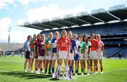 6 July 2009; Senior captains, from left, Denise Masterson, Dublin, Fiona McHale, Mayo, Eliza Downey, Down, Miriam O'Keeffe, representing Galway, Mags O'Donoghue, Kerry, Emma McEvoy, Laois, Mary O'Connor, Cork, Gillian O'Brien, Tipperary, Sharon Courtney, representing Monaghan, Teresa Mylott, Leitrim, Aisling Holton, Kildare, Caroline O'Halon, Armagh, and Kelly Hackett, representing Tyrone, at the launch of the TG4 Ladies Football All-Ireland Championships. Croke Park, Dublin. Picture credit: Stephen McCarthy / SPORTSFILE