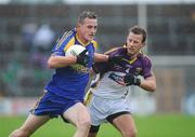 11 July 2009; Kevin Higgins, Roscommon, in action against Niall Murphy, Wexford. GAA Football All-Ireland Senior Championship Qualifier, Round 2, Wexford v Roscommon, Wexford Park, Wexford. Picture credit: Matt Browne / SPORTSFILE