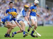 12 July 2009; Maurice Shanahan, Waterford, is crowded out by Padraic Maher, left, and Brendan Maher, Tipperary. GAA Hurling Munster Senior Championship Final, Tipperary v Waterford, Semple Stadium, Thurles, Co. Tipperary. Picture credit: Brendan Moran / SPORTSFILE