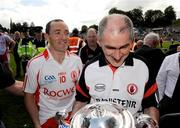 19 July 2009; Tyrone manager, Mickey Harte, along with Captain, Brian Dooher, after the game. GAA Football Ulster Senior Championship Final, Tyrone v Antrim, St Tighearnach's Park, Clones, Co. Monaghan. Picture credit: Oliver McVeigh / SPORTSFILE