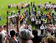 19 July 2009; Brian Dooher lifts the Anglo Celt Cup. GAA Football Ulster Senior Championship Final, Tyrone v Antrim, St Tighearnach's Park, Clones, Co. Monaghan. Picture credit: Michael Cullen / SPORTSFILE