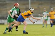 18 July 2009; Sharon O'Loughlin, Clare, in action against Niamh Mulcahy, Limerick. Gala Senior Camogie Championship, Group 2, Round 3, Clare v Limerick, Cusack Park, Ennis, Co. Clare. Picture credit: Diarmuid Greene / SPORTSFILE