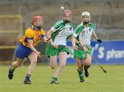 18 July 2009; Deirdre Murphy, Clare, in action against Niamh Mulcahy, centre and Deirdre Fizpatrick, Limerick. Gala Senior Camogie Championship, Group 2, Round 3, Clare v Limerick, Cusack Park, Ennis, Co. Clare. Picture credit: Diarmuid Greene / SPORTSFILE