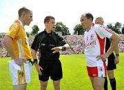 19 July 2009; Brian Dooher, Tyrone, and Paddy Cunningham, Antrim at the toss with referee Padraig Hughes, Armagh. GAA Football Ulster Senior Championship Final, Tyrone v Antrim, St Tighearnach's Park, Clones, Co. Monaghan. Picture credit: Michael Cullen / SPORTSFILE