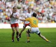 19 July 2009; Brian Dooher, Tyrone, in action against Michael McCann, Antrim. GAA Football Ulster Senior Championship Final, Tyrone v Antrim, St Tighearnach's Park, Clones, Co. Monaghan. Picture credit: Oliver McVeigh / SPORTSFILE