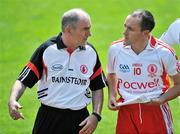 19 July 2009; Tyrone manager Mickey Harte in conversation with captain Brian Dooher before the match. GAA Football Ulster Senior Championship Final, Tyrone v Antrim, St Tighearnach's Park, Clones, Co. Monaghan. Picture credit: Brian Lawless / SPORTSFILE
