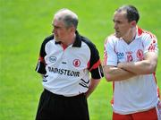 19 July 2009; Tyrone manager Mickey Harte with captain Brian Dooher before the match. GAA Football Ulster Senior Championship Final, Tyrone v Antrim, St Tighearnach's Park, Clones, Co. Monaghan. Picture credit: Brian Lawless / SPORTSFILE
