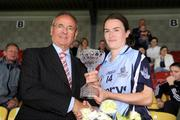 19 July 2009; Sinead Ahern, Dublin, is presented with the player of the match award by Sean Mac Maolain, President of the Leinster Council. TG4 Ladies Football Leinster Senior Championship Final, Dublin v Kildare, Dr. Cullen Park, Carlow. Picture credit: Pat Murphy / SPORTSFILE