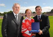 19 July 2009; Uachtarán Chumann Lúthchleas Gael Criostóir Ó Cuana, left, and Ulster GAA President, Tom Daly, right, present Anne Dooher, Tyrone, sister of Brian Dooher, with a special 125 Celebrations momento of All Ireland Captains before the GAA Football Ulster Senior Championship Final, Tyrone v Antrim, St Tighearnach's Park, Clones, Co. Monaghan. Picture credit: Oliver McVeigh / SPORTSFILE