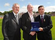 19 July 2009; Uachtarán Chumann Lúthchleas Gael Criostóir Ó Cuana, left, and Ulster GAA President Tom Daly, right, present Chris Lawn, Tyrone, representing Peter Canavan, with a special 125 Celebrations momento of All Ireland Captains, before the GAA Football Ulster Senior Championship Final, Tyrone v Antrim, St Tighearnach's Park, Clones, Co. Monaghan. Picture credit: Oliver McVeigh / SPORTSFILE