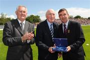 19 July 2009; Uachtarán Chumann Lúthchleas Gael Criostóir Ó Cuana, left, and Ulster GAA President Tom Daly, right, present Mick Higgins, Cavan, with a special 125 Celebrations momento of All Ireland Captains before the GAA Football Ulster Senior Championship Final, Tyrone v Antrim, St Tighearnach's Park, Clones, Co. Monaghan. Picture credit: Oliver McVeigh / SPORTSFILE