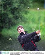 July 1997; Padraig Harrington playing from the water at the 13th green during the Murphy's Irish Open at Druid's Glen. Golf. Picture credit; David Maher/SPORTSFILE