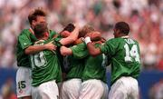 18 June 1994; Ray Houghton of Republic of Ireland celebrates after scoring his side's first goal with team-mates, from left, Tommy Coyne, John Sheridan, Steve Staunton and Phil Babb, during the FIFA World Cup 1994 Group E match between Republic of Ireland and Italy at Giants Stadium in New Jersey, USA. Photo by Ray McManus/Sportsfile