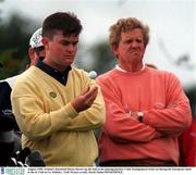 August 1998; Ireland's Raymond Burns throws up the ball as his playing partner Colin Montgomerie looks on during the European Open at the K Club in Co. Kildare.  Golf. Picture credit; David Maher/SPORTSFILE.
