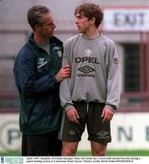 April  1997; Republic of Ireland manager Mick McCarthy has a word with Gareth Farrelly during a squad raining session at Lansdowne Road. Soccer. Picture credit; David Maher/SPORTSFILE