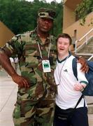 US army Staff Sargent Tony Anthony, Rockymount, North Carolina with Grant Wilson, a member of the Special Olympics Ireland Swimming team before the start of the opening ceromony. 1999 Special Olympics World Summer Games in Raleigh, North Carolina, USA. Picture credit; Ray McManus/SPORTSFILE