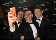 6 November 2015; Kilkenny players, left to right, Joey Holden, Ger Aylward, Cillian Buckley, Paul Murphy, take a selfie at the GAA GPA All-Star Awards 2015 Sponsored by Opel. Convention Centre, Dublin. Picture credit: Paul Mohan / SPORTSFILE