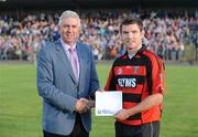 29 July 2009; Mark Landers, Cappoquin, receives his prize for winning the Bord Gais Energy Crossbar Challenge from Ger Cunningham of Bord Gais Energy at half-time in the Bord Gais Energy GAA Munster U21 Hurling Championship Final between Waterford and Clare, Fraher Field, Dungarvan, Co Waterford. Picture credit: Matt Browne / SPORTSFILE