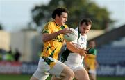 1 August 2009; Brian Meade, Meath, in action against Jason Stokes, Limerick. GAA Football All-Ireland Senior Championship Qualifier, Round 4, Meath v Limerick, O'Moore Park, Portlaoise, Co. Laois. Picture credit: Matt Browne / SPORTSFILE