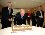 9 August 2009; Former GAA President and Mayo footballer Dr. Mick Loftus blows out the candles in a cake presented to him on the occasion of his 80th birthday as Uachtarán Chumann Lúthchleas Gael Criostóir Ó Cuana , left, and Ard Stiúrthoir Paraic Duffy, right, watch on. Presentation to Dr. Mick Loftus. Croke Park, Dublin. Picture credit: Ray McManus / SPORTSFILE