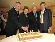 9 August 2009; Former GAA President and Mayo footballer Dr. Mick Loftus cuts a cake presented to him on the occasion of his 80th birthday with his wife Eidie, Uachtarán Chumann Lúthchleas Gael Criostóir Ó Cuana, left, and Ard Stiúrthoir Paraic Duffy, right. Dr. Mick Loftus Celebrates 80th Birthday, Croke Park, Dublin. Picture credit: Ray McManus / SPORTSFILE