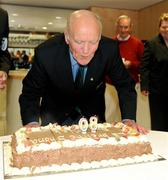 9 August 2009; Former GAA President and Mayo footballer Dr. Mick Loftus blows out the candles in a cake presented to him on the occasion of his 80th birthday. Dr. Mick Loftus Celebrates 80th Birthday, Croke Park, Dublin. Picture credit: Ray McManus / SPORTSFILE