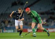21 November 2015; Paul Divilly, Ireland, in action against Fraser Heath, Scotland. 2015 Senior Hurling/Shinty International Series, 2nd leg, Ireland v Scotland. Croke Park, Dublin. Picture credit: Piaras Ó Mídheach / SPORTSFILE