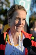 22 November 2015; Fionnuala McCormack, Kilcoole A.C., is interviewed after winning the Senior Women's event. GloHealth National Cross Country Championships, Santry Demesne, Dublin. Picture credit: Cody Glenn / SPORTSFILE