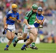 16 August 2009; Andrew O'Shaughnessy, Limerick, in action against Shane McGrath, left, and Paddy Stapleton, Tipperary. GAA Hurling All-Ireland Senior Championship Semi-Final, Tipperary v Limerick, Croke Park, Dublin. Picture credit: Ray McManus / SPORTSFILE