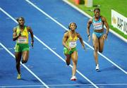 17 August 2009; Shelley-Ann Fraser of Jamaica, on her way to victory in the Women's 100m Final, ahead of second placed Kerron Stewart, also of Jamaica, and Debbie Ferguson MacKenzie of the Bahamas, winning in a time of 10.73 secs. 12th IAAF World Championships in Athletics, Olympic Stadium, Berlin, Germany. Picture credit: Brendan Moran  / SPORTSFILE