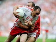 23 August 2009; Brian Dooher, Tyrone, in action against John Miskella, Cork. GAA Football All-Ireland Senior Championship Semi-Final, Tyrone v Cork, Croke Park, Dublin. Picture credit: Oliver McVeigh / SPORTSFILE
