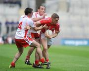 23 August 2009; Daniel Goulding, Cork, in action against Ryan McMenamin and Brian Dooher, Tyrone. GAA Football All-Ireland Senior Championship Semi-Final, Tyrone v Cork, Croke Park, Dublin. Picture credit: Oliver McVeigh / SPORTSFILE
