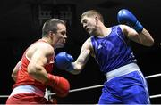 28 November 2015; Stephen Lawrence, right, Holy Family Boxing Club, Drogheda, Co. Louth, exchanges punches with Darren O'Neill, Paulstown Boxing Club, Co. Kilkenny, during their Heavyweight 91kg Quarter-Final bout. IABA National Elite Male Championships. National Stadium, Dublin. Picture credit: Paul Mohan / SPORTSFILE
