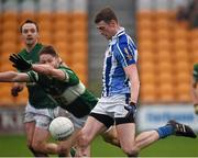 6 December 2015; Aran Waters, under pressure from the Portlaoise full back Cahir Healy, kicks a late point for Ballyboden St Enda's, which proved to be the winner. AIB Leinster GAA Senior Club Football Championship Final, Portlaoise v Ballyboden St Enda's. O'Connor Park, Tullamore, Co. Offaly. Picture credit: Ray McManus / SPORTSFILE