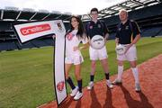 7 September 2009; Pictured is model Georgia Salpa with Dublin footballers Mark Davoren and Mark Vaughan, right, at the launch of the oneills.com Kilmacud Crokes All-Ireland football sevens tournament in Croke Park today. The renowned event attracts top club sides from around the country and will take place on 19 September. Croke Park, Dublin. Picture credit: Paul Mohan / SPORTSFILE