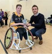 12 December 2015; Kilkenny hurler David Herity presents Conn Nagle, Ulster/Antrim, with the player of the tournament, during the M. Donnelly GAA Wheelchair Hurling Interprovincial All-Star Awards & All-Ireland Finals. I.T. Blanchardstown, Blanchardstown, Dublin 15. Picture credit: Oliver McVeigh / SPORTSFILE