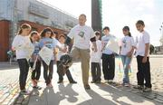 10 September 2009; Actor Gary Cooke of Apres Match shows off his soccer skills in front of 5th class students from Griffeen Valley Educate Together School, Lucan, Dublin, from left, Petra Haraszti, Louise Monaghan, Neola Gavril, Arslan Boulafrad, Naoise Barry, Evan Roy, Nadia Khan and Ajeet Bisht at the launch of the SARI Soccerfest meets Concern KiteFest Festival. Smithfield Square, Smithfield, Dublin. Picture Credit: Pat Murphy / SPORTSFILE