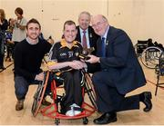 12 December 2015; Conor McGrotty, Ulster/Derry, receives the winners trophy from David Herity, left, Kilkenny Hurler, Martin McAviney, Ulster GAA President, and John Horan, right, Leinster GAA President, during the M. Donnelly GAA Wheelchair Hurling Interprovincial All-Star Awards & All-Ireland Finals. I.T. Blanchardstown, Blanchardstown, Dublin 15. Picture credit: Oliver McVeigh / SPORTSFILE