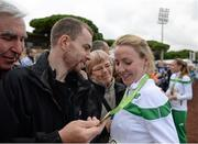 13 December 2015; Ireland's Ciara Durkan is greeted by her family after winning team bronze in the Senior Women's event. SPAR European Cross Country Championships Hyeres 2015. Paray Le Monial, France Picture credit: Cody Glenn / SPORTSFILE