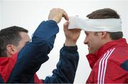 15 December 2015; Munster's CJ Stander gets some head strapping applied by lead physiotherapist Shea McAleer during squad training. Munster Rugby Squad Training & Press Conference. Limerick. Picture credit: Diarmuid Greene / SPORTSFILE