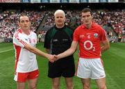 23 August 2009; Tyrone captain Brian Dooher and Cork captain Graham Canty shake hands in front of Referee John Bannon before the game. GAA Football All-Ireland Senior Championship Semi-Final, Tyrone v Cork, Croke Park, Dublin. Picture credit: Ray McManus / SPORTSFILE
