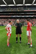 23 August 2009; Referee John Bannon tosses the coin in front of Tyrone captain Brian Dooher and Cork captain Graham Canty before the game. GAA Football All-Ireland Senior Championship Semi-Final, Tyrone v Cork, Croke Park, Dublin. Picture credit: Ray McManus / SPORTSFILE