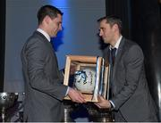 18 December 2015; Dublin's Alan Brogan, who recently announced his retirement, is presented with with an All Ireland Final Football, signed by his team mates, by the team captain Stephen Cluxton at the presentation of O'Byrne Cup, Allianz League, Leinster and All Ireland Championship medals at Croke Park, Dublin. Picture credit: Ray McManus / SPORTSFILE